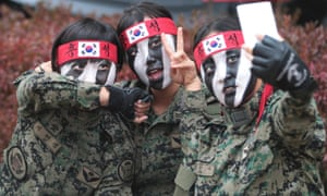 Members of South Korean Army Special Forces take pictures at a welcoming ceremony at Seoul International Aerospace and Defense Exhibition, South Korea.