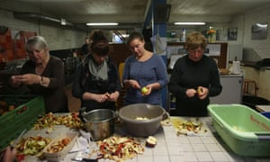 Volunteers working for SALAM prepare hot meals for daily distribution to migrants in Calais.
