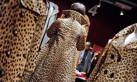 A woman tries a fur coat