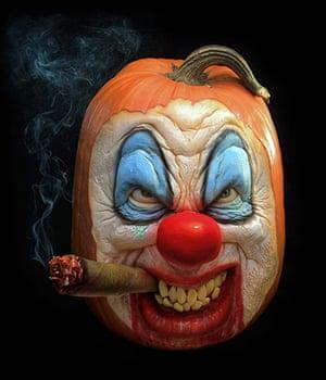 Pumpkin carving: A clown face carved out of a pumpkin