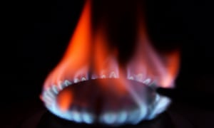A flame burns on a gas hob