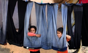 Palestinian children outside their house in the Shati refugee camp, Gaza.