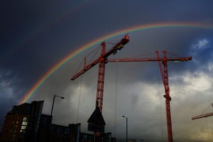 Construction cranes are skillfully framed by a rainbow in Manchester city centre. The 2013 Deloitte Real Estate annual crane survey revealed that, of the five major regional cities ( Manchester, Birmingham, Edinburgh, Leeds and Glasgow ) Manchester had the highest number of new developments under construction.
