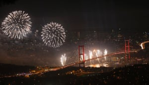 The Bosphorus Bridge that links the city's European and Asian sides, with the European side in the background, lights up with a fireworks display during the Republic Day celebrations in Istanbul. Turkey marks the 90th anniversary of the Republic Day.