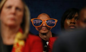 A protester against the practices of US security agenices sits in the audience as intelligence officials testify at a hearing on Capitol Hill.