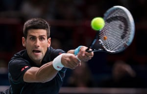 Novak Djokovic of Serbia returns the ball to Pierre-Hugues Herbert of France during their first round match at the BNP Paribas 2013 Masters tennis tournament in Paris, France.