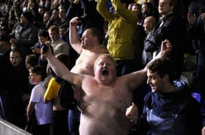 Bare chested Stoke fans celebrate after Stoke win 4-2 on penaltys during the Capital Cup Fourth Round game between Birmingham City and Stoke City at St Andrews stadium in Birmingham, England.