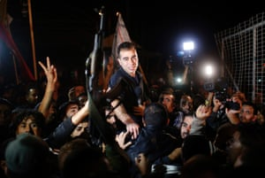 A released Palestinian prisoner reacts upon his arrival at the Erez crossing between Israel and the northern Gaza Strip. The release of 26 Palestinian prisoners by Israel has provoked feuding within Israel's governing coalition, already under strain from U.S.-brokered peace talks.