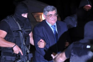 Extreme-right Golden Dawn party leader Nikolaos Michaloliakos is escorted by anti-terror police after judicial authorities sent him to jail ahead of his trial, on October 2, 2013 in Athens, Greece.