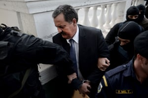 Greek Golden Dawn lawmaker Christos Pappas is ecorted to a court in Athens on October 3, 2013. T