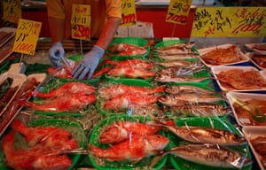 Fukushima: A vendor offers fish for sale at a market in Iwaki town