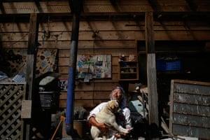 Fukushima: Keigo Sakamoto holds Atom one of his 21 dogs