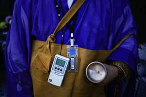 Fukushima: A Buddhist monk wears a Geiger counter
