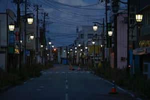 Fukushima: Street lamps light the street in Namie