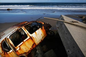 Fukushima: A beach is littered with tsunami barriers, wreckages of cars & other debris
