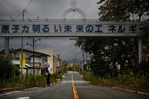Fukushima: A woman leaves after a brief visit to Futaba