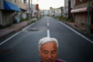Fukushima: Naoto Matsumura poses for pictures in an empty street