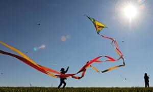 A child runs with its kite during bright sunshine near Chemnitz, eastern Germany.