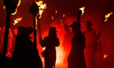 Participants carrying flaming torches during the Bonfire Night procession in Lewes 5 November 2008