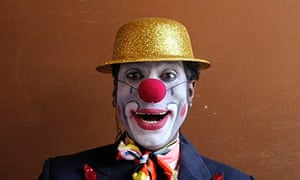 Lead clown Biju poses for a picture before a show at the Rambo Circus in Mumbai
