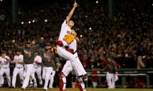 Koji Uehara and David Ross of the Boston Red Sox celebrate winning the 2013 World Series