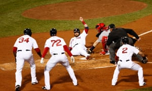Jonny Gomes slides in safely against St. Louis Cardinals catcher Yadier Molina as David Ortiz, Xander Bogaerts and Jacoby Ellsbury look on during the third inning.