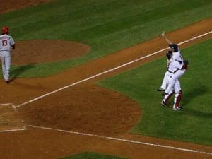 It's over. Boston Red Sox closer Koji Uehara and catcher David Ross celebrate as St. Louis Cardinals'  Matt Carpenter disconsolately walks away