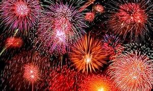 fireworks explode across a night sky