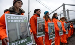 Greenpeace activists holds posters with pictures of the 'Artic 30' detained Greenpeace activists as they demonstrate in Moscow on 18 October 2013.