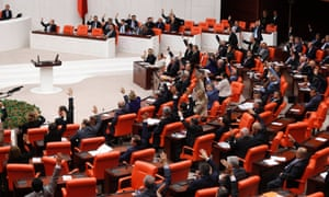 Turkey's parliament votes to extend by a year a mandate that allows the military to send troops into Syria if the need arises