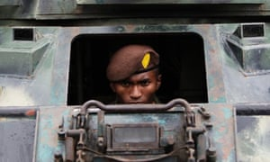 A member of Honduras' military police sits in a tank during a presentation in Mateo. The new military police unit consisting of 5,000 personnel who will be in charge of police operations, public order and safety.