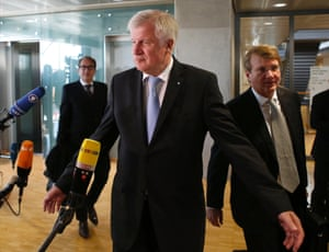Bavarian state Premier and leader of the Christian Social Union (CSU) Horst Seehofer (C) arrives for a meeting of senior party leaders before the first exploratory talks between Germany's conservative (CDU/CSU) parties and the Social Democrats in Berlin October 4, 2013.