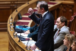 Portugal's Prime Minister Pedro Passos Coelho (L) intervenes during the biweekly debate with his presence at the Parliament, accompanied by the Vice Prime Minister Paulo Portas (C) and by the Minister of Finance Maria Luis Albuquerque (R), in Lisbon, Portugal, 04 October 2013.