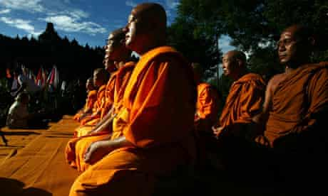 Buddhist monks meditate in Indonesia
