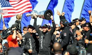 Ben Ainslie lifts the America's Cup trophy after Oracle Team US's victory in San Francisco