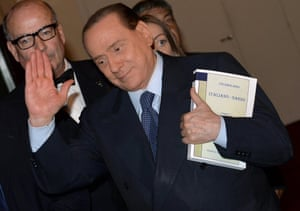 A file photograph showing Italy's former Prime Minister Silvio Berlusconi, leader of the People of Freedom party (PDL), leaving the Italian Deputy Chamber in Rome after a meeting with his parliamentary group, 30 September 2013.