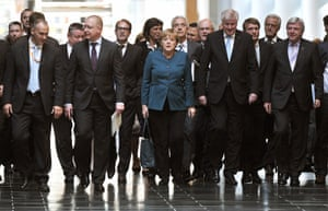 German Chancellor Angela Merkel (C) arrives with her delegation to the preliminary talks at Jakob-Kaiser-Haus in Berlin, Germany, 04 October 2013.