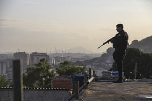 Favela clearance: An armed soldier takes position in the favela, as part of a policing progra