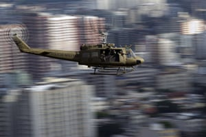 Favela clearance: A Brazilian military police helicopter flies over the Lins favela (shantyto