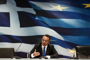 Greek Deputy Finance Minister Christos Staikouras addresses reporters during a briefing at a ministry hall in Athens October 7, 2013.