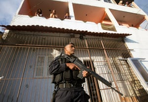 Favela clearance: A police officer patrols the Lins slum complex during an operation to insta