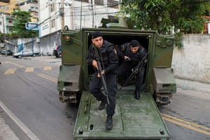 Favela clearances: Special Police Operations Battalion policemen get out of an armoured vehicl