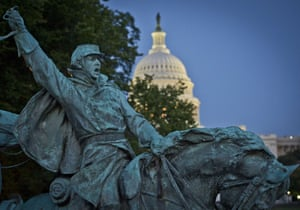 The US Capitol seen at dusk behind the Ulysses S. Grant Memorial  in Washington, DC, October 6, 2013.