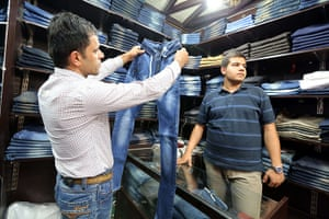 Iranian jeans: A man looks at a pair of jeans at shop in Tehran