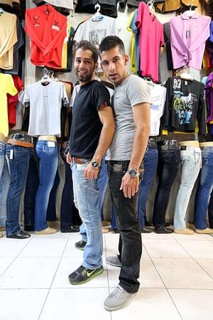 Iranian jeans: Men pose in a shop selling jeans in Tajrish Bazaar