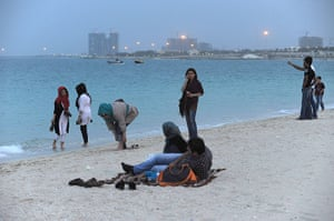 Iranian jeans: Women on the beach at dusk in Kish, a resort island in the Persian Gulf