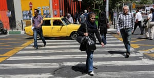 Iranian jeans: People cross a street near the Vanak public square in Tehran