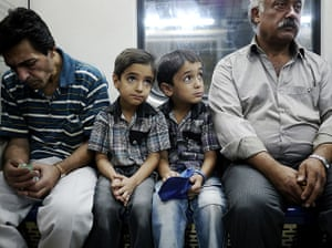 Iranian jeans: Two young twins on the Tehran Metro