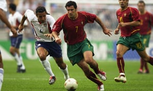 Luis Figo of Portugal is pursued by Pablo Mastroeni
