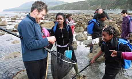 George Monbiot rockpooling with children from south-east london